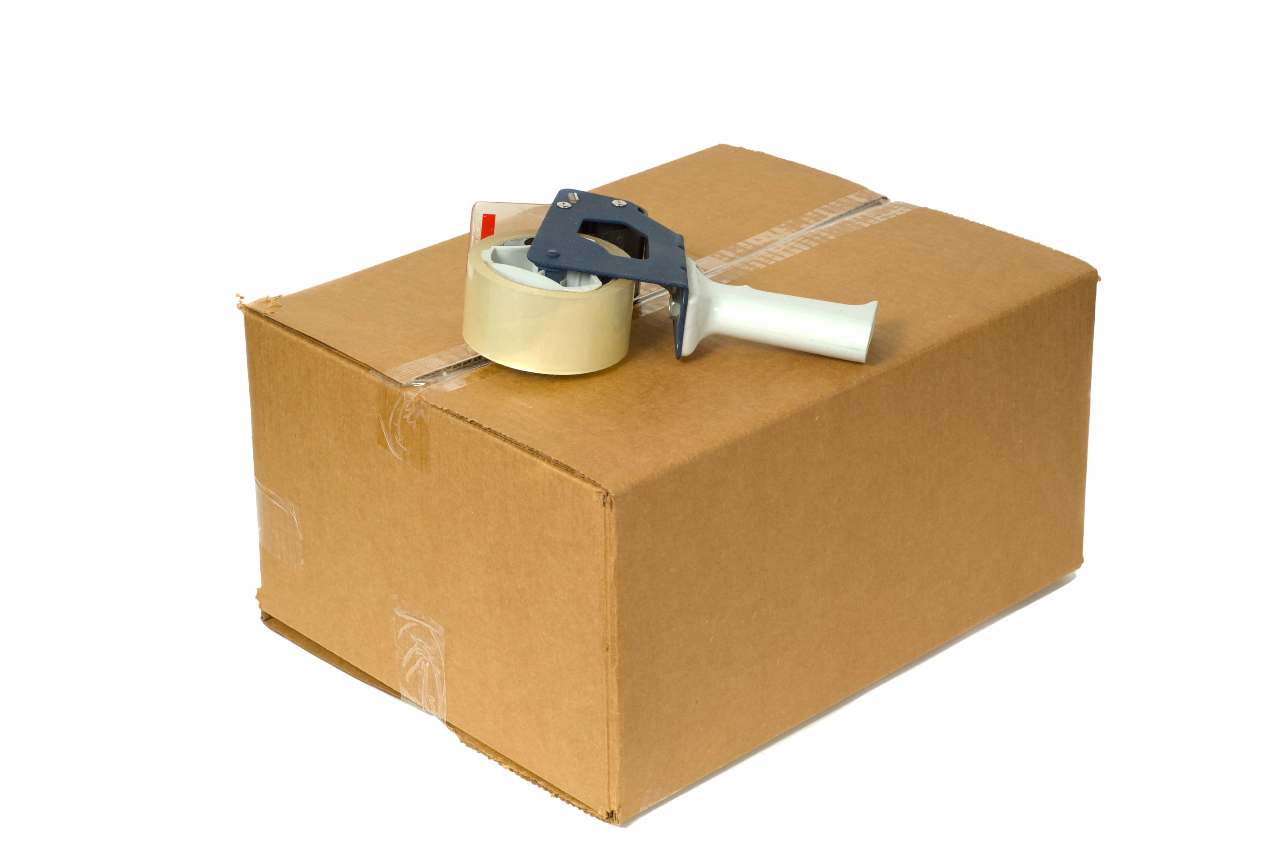 Shipping Box with a tape gun on top on white background space for copy on box or around box