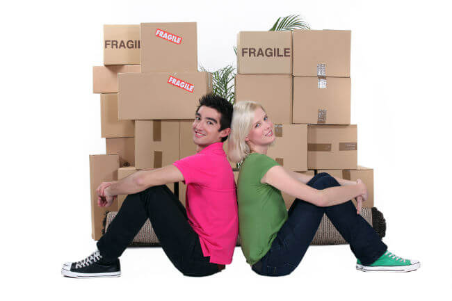 young couple in front of moving boxes